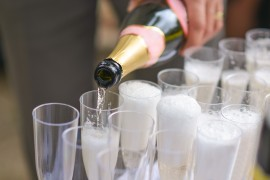 Someone poured a bottle champagne in glasses