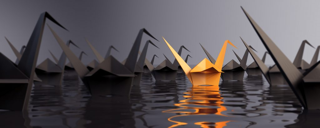 paper swans on water