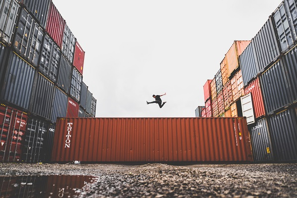 man jumping on international container
