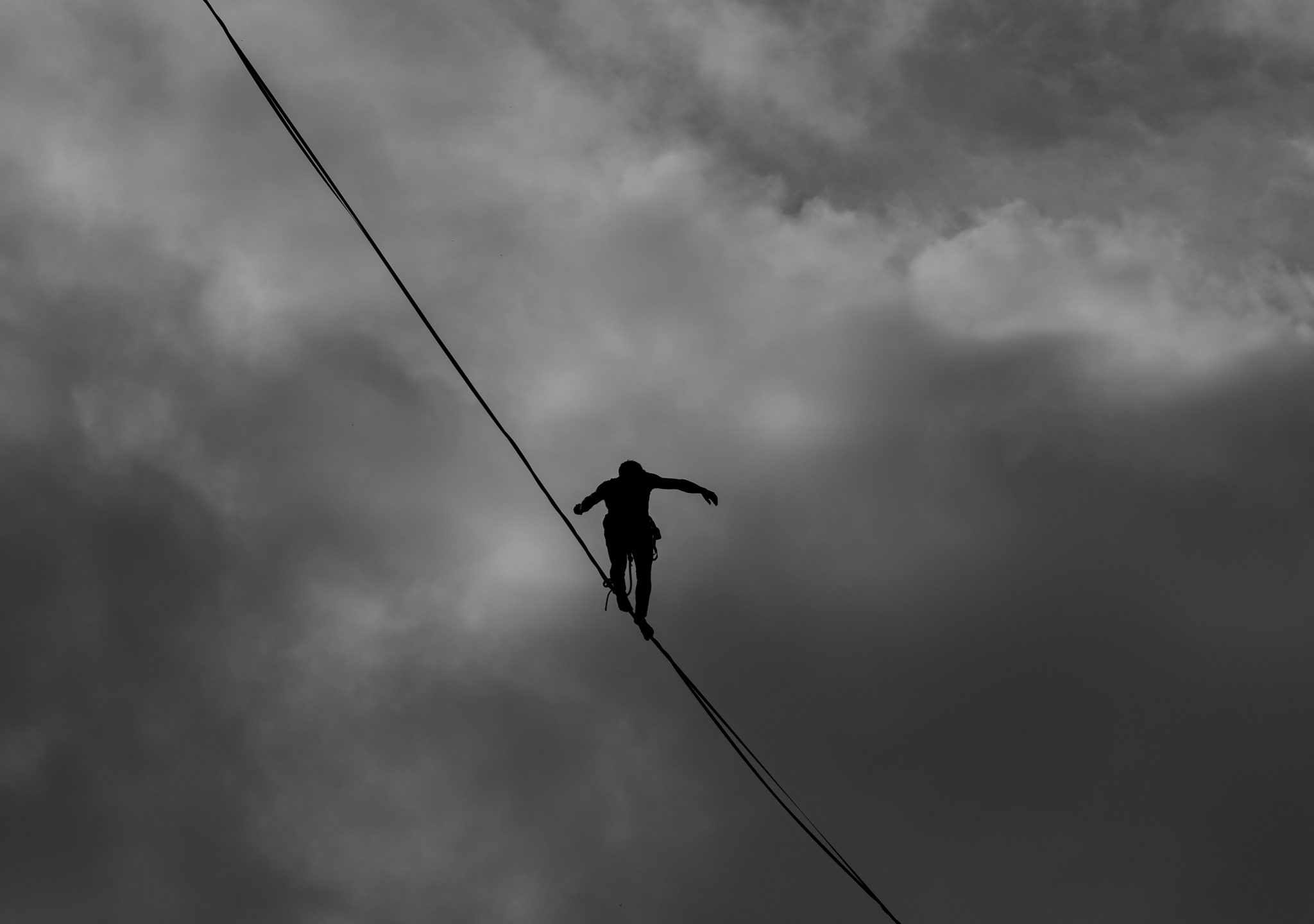 Man on tightrope