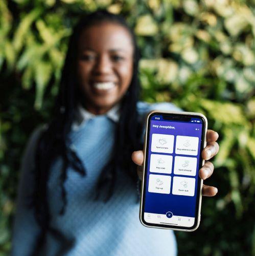 Woman showing Spot Money app