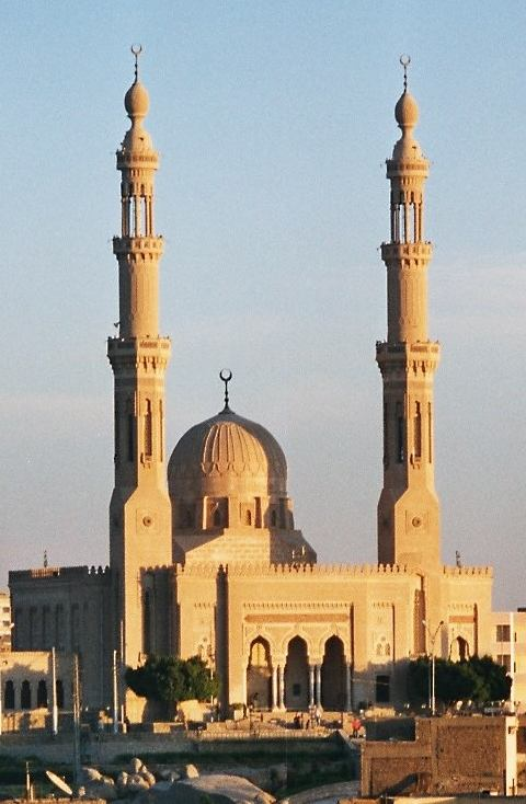 The adhan or call to prayer is broadcast from the minarets of Aswan mosque, Egypt