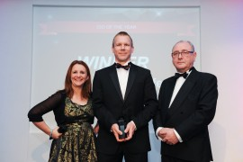 CIO of the Year Damian Sutcliffe, Goldman Sachs, with host Lucy Porter and editor David Bannister